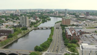 AF0001_000735 - HD stock footage aerial video follow Charles River and Soldiers Field Road to approach hotel in Allston, Massachusetts