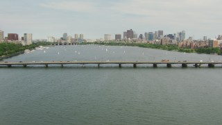 AF0001_000739 - HD stock footage aerial video fly over the Harvard Bridge to approach boats on Charles River and Downtown Boston, Massachusetts
