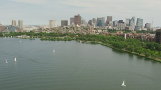 AF0001_000741 - Aerial stock footage of Approach Charles River Esplanade, Beacon Hill, and the city skyline, Downtown Boston, Massachusetts