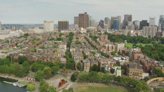 AF0001_000742 - Aerial stock footage of Fly over the Hatch Memorial Shell and Beacon Hill to approach Massachusetts State House, Downtown Boston, Massachusetts