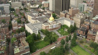 AF0001_000746 - HD stock footage aerial video tilt from Boston Common to reveal the Massachusetts State House in Downtown Boston, Massachusetts