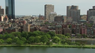 AF0001_000765 - HD stock footage aerial video of Back Bay Victorian brownstones seen from the Charles River in Downtown Boston, Massachusetts