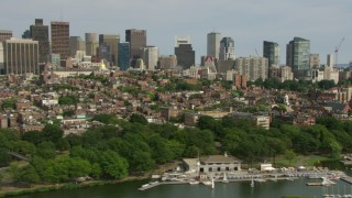 AF0001_000767 - Aerial stock footage of Charles River Esplanade, Beacon Hill row houses, skyscrapers in Downtown Boston, Massachusetts
