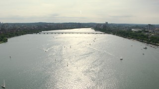 AF0001_000780 - HD stock footage aerial video pan across sailboats on the Charles River near the Harvard Bridge, Cambridge, Massachusetts