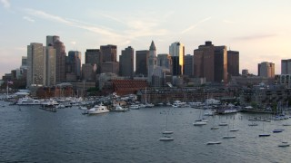 AF0001_000791 - HD stock footage aerial video of the city skyline and marina seen from the Charles River, Downtown Boston, Massachusetts, sunset