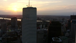 AF0001_000794 - HD stock footage aerial video flyby city skyscrapers in Downtown Boston, Massachusetts, at sunset, with a view of the Charles River