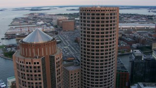 AF0001_000798 - HD stock footage aerial video orbit the tops of One and Two International Place, Downtown Boston, Massachusetts, twilight