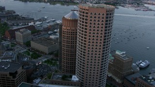 AF0001_000799 - Aerial stock footage of Orbit One and Two International Place, and flyby Downtown Boston, Massachusetts, twilight