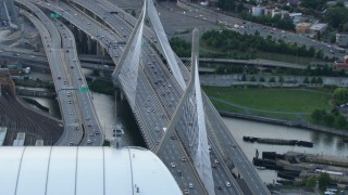AF0001_000801 - HD stock footage aerial video of light traffic on the Zakim Bridge in Boston, Massachusetts, twilight