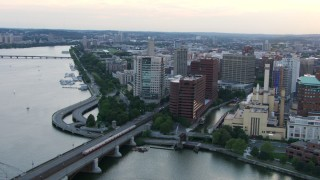 AF0001_000804 - HD stock footage aerial video of a commuter train crossing Longfellow Bridge toward Cambridge, Massachusetts, twilight