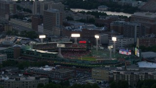 AF0001_000810 - HD stock footage aerial video of Fenway Park with a baseball game in progress, Boston, Massachusetts, twilight