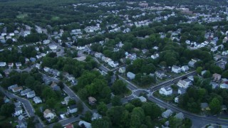AF0001_000812 - HD stock footage aerial video of suburban neighborhoods at sunset in Roslindale, Massachusetts, twilight