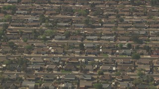 AF0001_000829 - HD stock footage aerial video of rows of homes in a suburban neighborhood in Peoria, Arizona