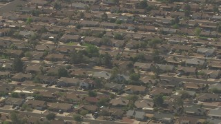 AF0001_000830 - HD stock footage aerial video of flying by homes in a suburban residential neighborhood, Peoria, Arizona