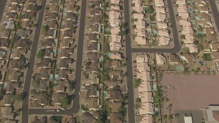 AF0001_000831 - HD stock footage aerial video of a bird's eye view of homes, reveal Sky View Elementary School, Peoria, Arizona