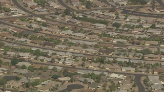 AF0001_000832 - HD stock footage aerial video of passing homes in a residential neighborhood, Sun City, Arizona