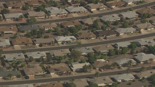 AF0001_000833 - Aerial stock footage of Streets lined with single story homes in Sun City, Arizona