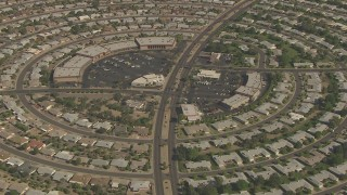 AF0001_000834 - Aerial stock footage of La Ronde Shopping Center circled by homes in Sun City, Arizona
