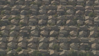 AF0001_000837 - HD stock footage aerial video of rows of tract homes in Surprise, Arizona