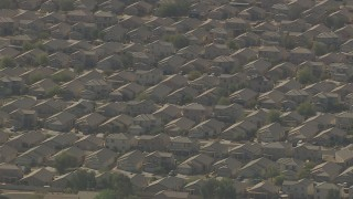 AF0001_000838 - Aerial stock footage of Tract homes in a suburban neighborhood in Surprise, Arizona