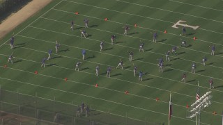 AF0001_000841 - HD stock footage aerial video of a sports team exercising on the field in Surprise, Arizona