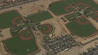 AF0001_000842 - HD stock footage aerial video of a bird's eye view of baseball diamonds, reveal Valley Vista High School, Surprise, Arizona