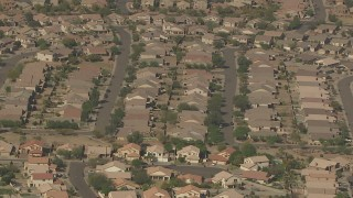 AF0001_000843 - HD stock footage aerial video approach and tilt to tract homes in a residential neighborhood, Surprise, Arizona