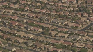 AF0001_000844 - Aerial stock footage of Rows of one-story tract homes in Surprise, Arizona