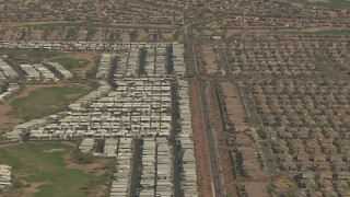 AF0001_000845 - HD stock footage aerial video of suburban neighborhoods, and reveal Happy Trails Resort, Surprise, Arizona