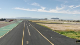 AF0001_000846 - Aerial stock footage of Lifting off from Tucson International Airport, Arizona