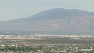 AF0001_000847 - HD stock footage aerial video of military airplanes at an aircraft boneyard, Davis Monthan AFB, Tucson, Arizona