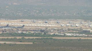 AF0001_000848 - HD stock footage aerial video of an aircraft boneyard at Davis Monthan AFB, Tucson, Arizona
