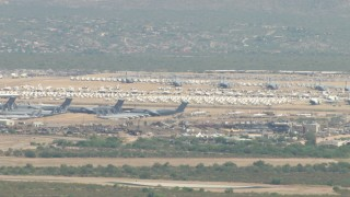 AF0001_000849 - Aerial stock footage of A military aircraft boneyard, Davis Monthan AFB, Tucson, Arizona