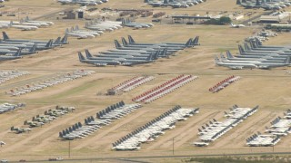 AF0001_000854 - HD stock footage aerial video of groups of military airplanes in an aircraft boneyard, Davis Monthan AFB, Tucson, Arizona