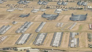 AF0001_000855 - HD stock footage aerial video of an aircraft boneyard with military planes at Davis Monthan AFB, Tucson, Arizona