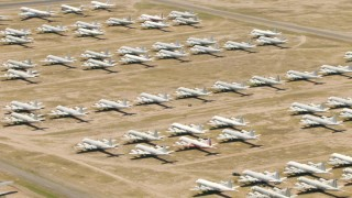 AF0001_000860 - HD stock footage aerial video of military propellor airplanes at the aircraft boneyard, Davis Monthan AFB, Tucson, Arizona