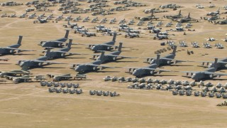 AF0001_000865 - Aerial stock footage of Military airplanes and helicopters at the aircraft boneyard, Davis Monthan AFB, Tucson, Arizona