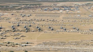 AF0001_000866 - HD stock footage aerial video of airplanes at the base's aircraft boneyard, Davis Monthan AFB, Tucson, Arizona