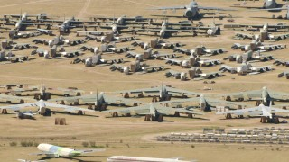 AF0001_000867 - HD stock footage aerial video of reverse view of military airplanes at an aircraft boneyard, Davis Monthan AFB, Tucson, Arizona