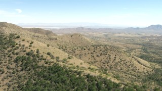 AF0001_000871 - HD stock footage aerial video of flying over Mae West Peaks to approach Dragoon, Cochise County, Arizona