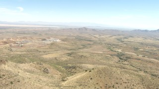 AF0001_000873 - HD stock footage aerial video approach a desert quarry near Dragoon, Arizona