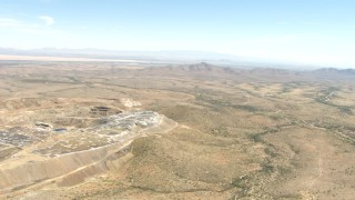 AF0001_000874 - HD stock footage aerial video approach a desert quarry near Dragoon, Arizona