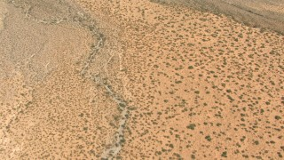 AF0001_000890 - HD stock footage aerial video of a bird's eye view of dry desert creek beds, New Mexico
