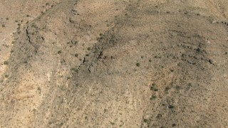 AF0001_000891 - HD stock footage aerial video bird's eye view of desert hills, New Mexico