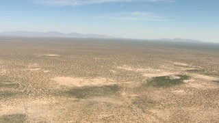 AF0001_000893 - HD stock footage aerial video of flying over a wide desert plain in New Mexico