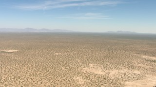 AF0001_000894 - Aerial stock footage of A wide desert plain in New Mexico