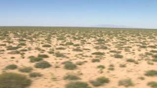 AF0001_000903 - HD stock footage aerial video flyby desert vegetation in a wide plain in New Mexico