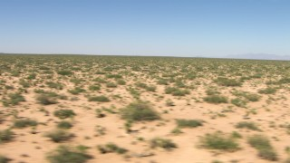 AF0001_000904 - HD stock footage aerial video flyby a wide desert plain in New Mexico