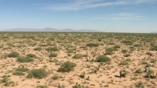 AF0001_000906 - HD stock footage aerial video of desert vegetation on a wide plain in New Mexico