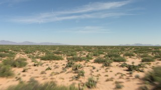 AF0001_000913 - HD stock footage aerial video of an arid desert plain with vegetation in New Mexico